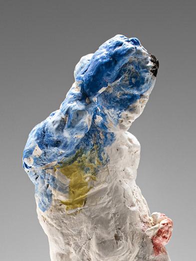 Statue, blue arm